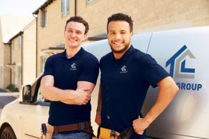 Portrait Of Two Young Tradesmen By Their Van